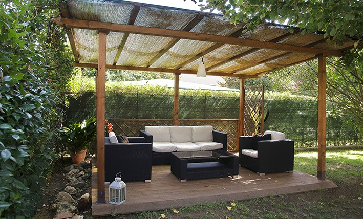 Covered patio with arm chairs, Villa Angela, one of the villas you can rent from Glesus, Wedding & Travel Services in Italy